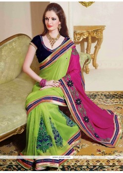 Conspicuous Green And Pink Sahded Net Saree