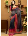 Fascinating Grey And Black Shaded Faux Georgette Printed Saree