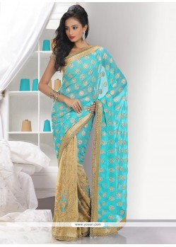 Pristine Turquoise And Beige Shimmer Georgette Saree