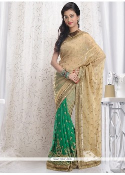 Magnificent Beige And Green Shimmer Georgette Saree