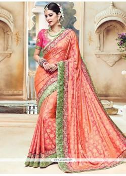 Riveting Orange Traditional Designer Saree
