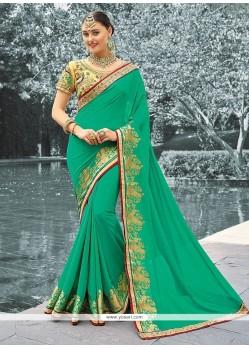 Stupendous Sea Green Zari Work Faux Georgette Classic Designer Saree