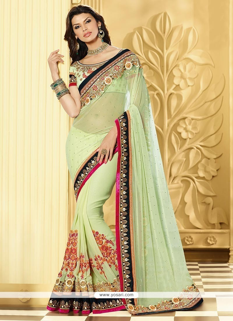 Incredible Green Shaded Net Half And Half Saree