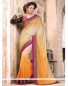 Dignified Orange And Cream Georgette Saree