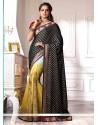 Lustrous Black And Yellow Shaded Chiffon Designer Saree