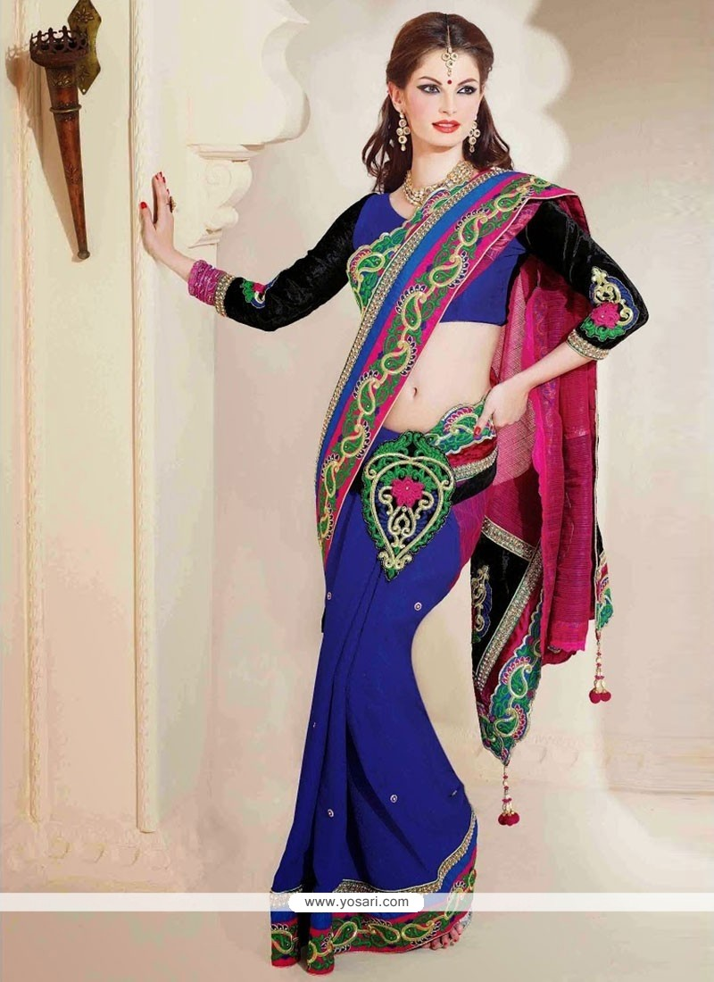 Luxurious Blue And Pink Faux Crepe And Fancy Fabric Saree