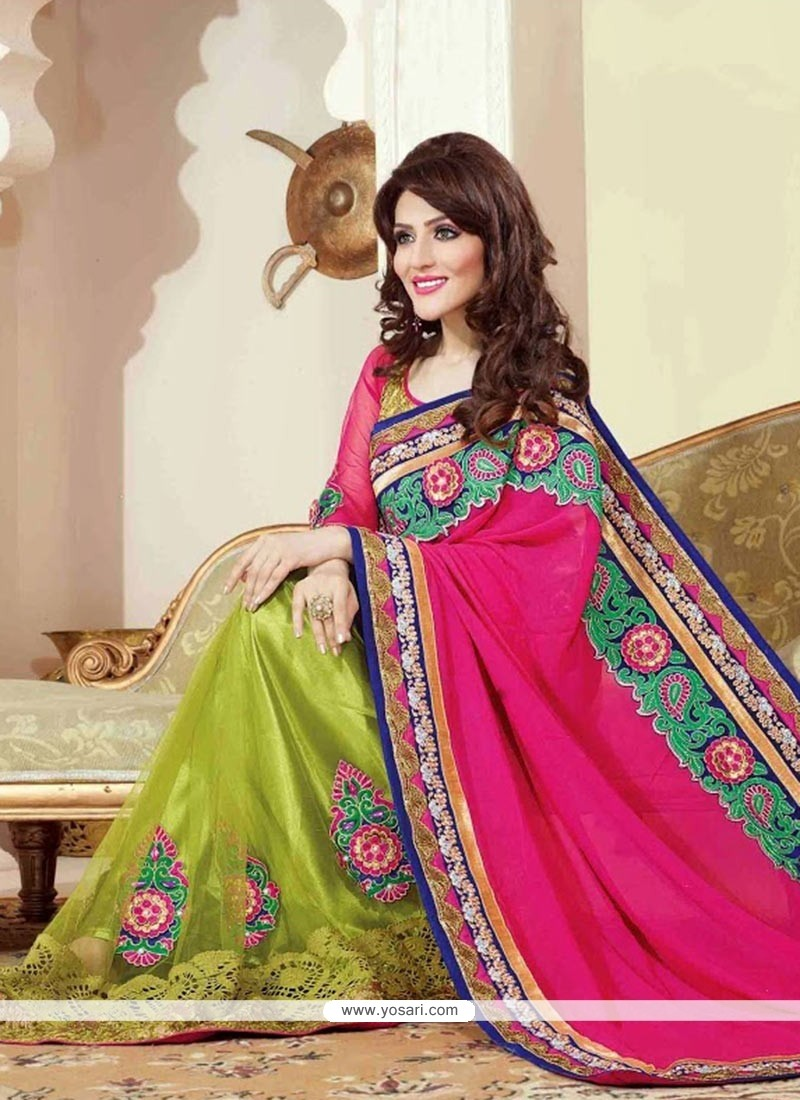 Bedazzling Green And Pink Shade Net And Faux Georgette Saree