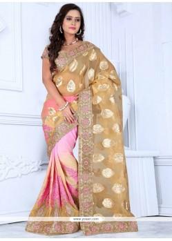 Exciting Beige And Pink Zari Work Georgette Designer Saree