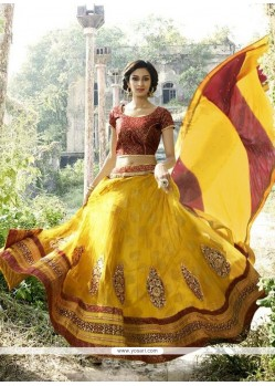 Girlish Net Yellow A Line Lehenga Choli