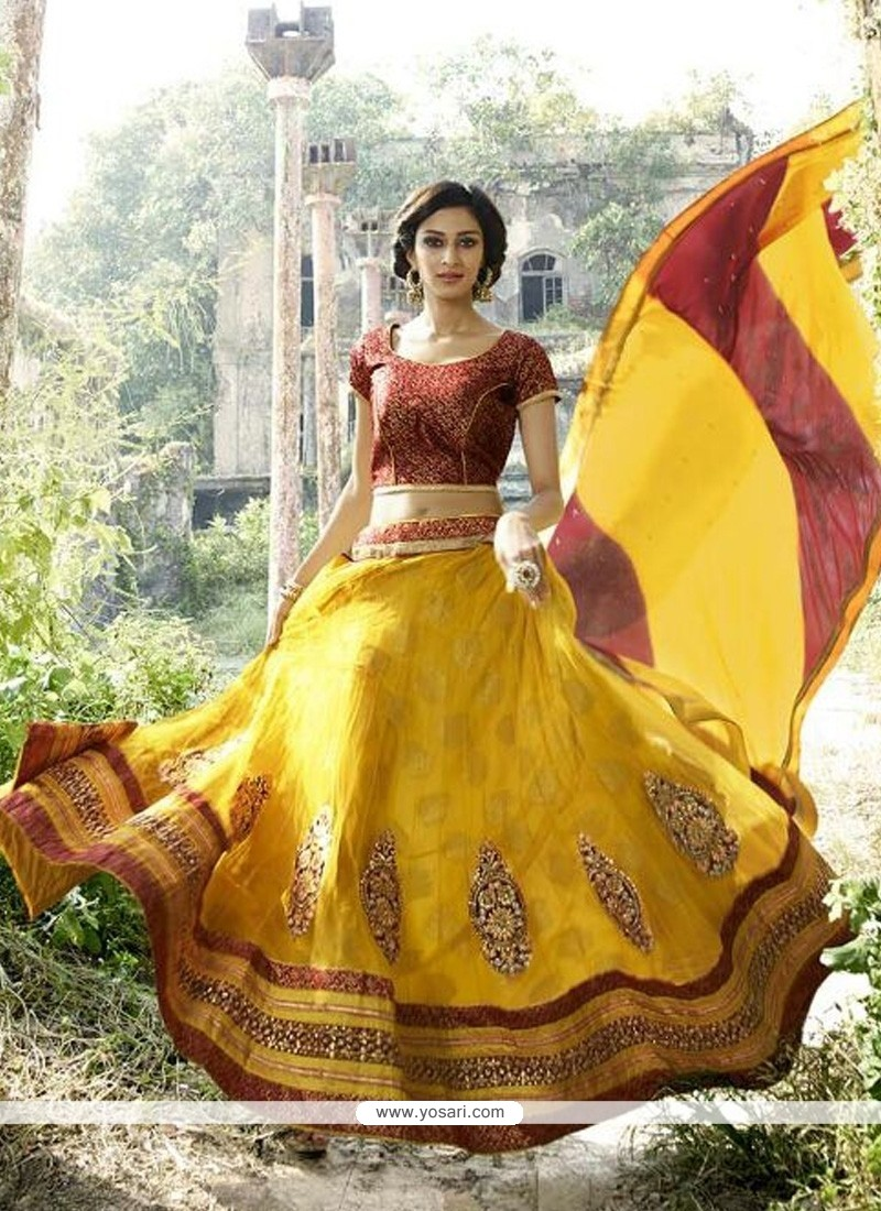 Girlish Net Yellow A Line Lehenga Choli