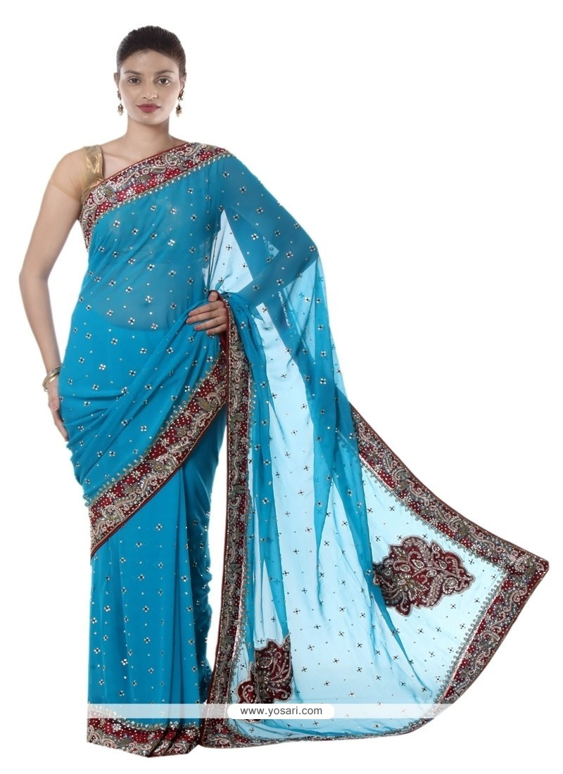 Whimsical Patch Border Work Turquoise Designer Saree
