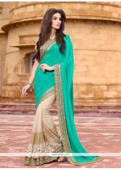 Ideal Satin Beige And Sea Green Patch Border Work Designer Saree