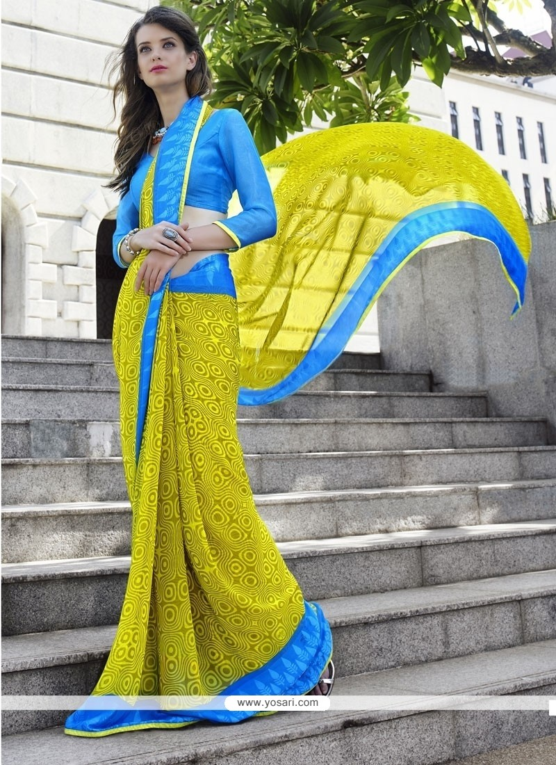 Sonorous Turquoise And Yellow Patch Border Work Georgette Casual Saree