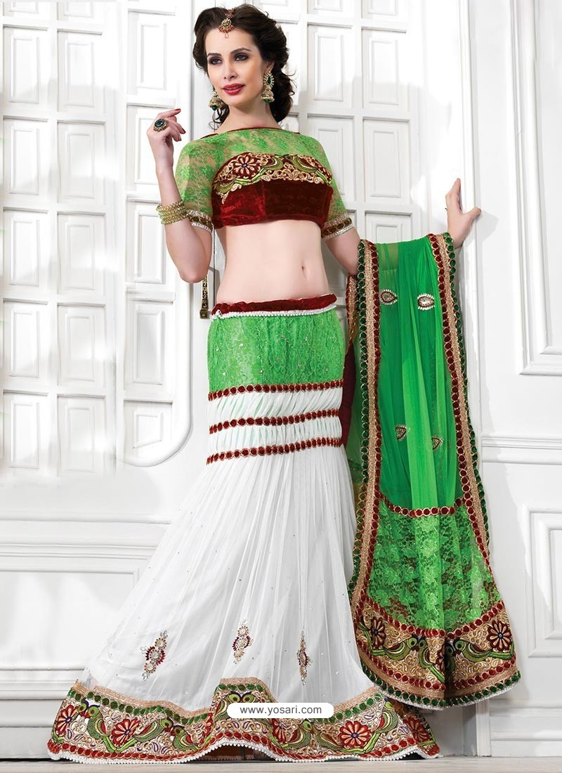 Enticing White Appliqued Net Lehenga Choli