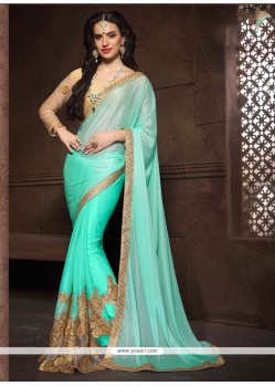 Impressive Patch Border Work Turquoise Designer Saree