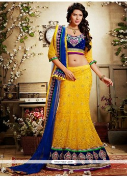Lovely Yellow Crystals And Net Lehenga Choli