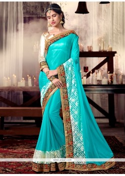 Fetching Turquoise Embroidered Work Designer Saree