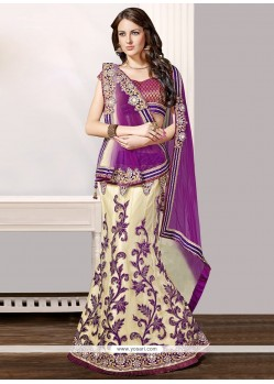 Charming Cream And Purple Net Fish Cut Lehenga Choli