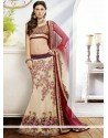 Captivating Cream Applique Net Fish Cut Lehenga Choli