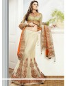 Charismatic Cream Embroidery Net Lehenga Choli