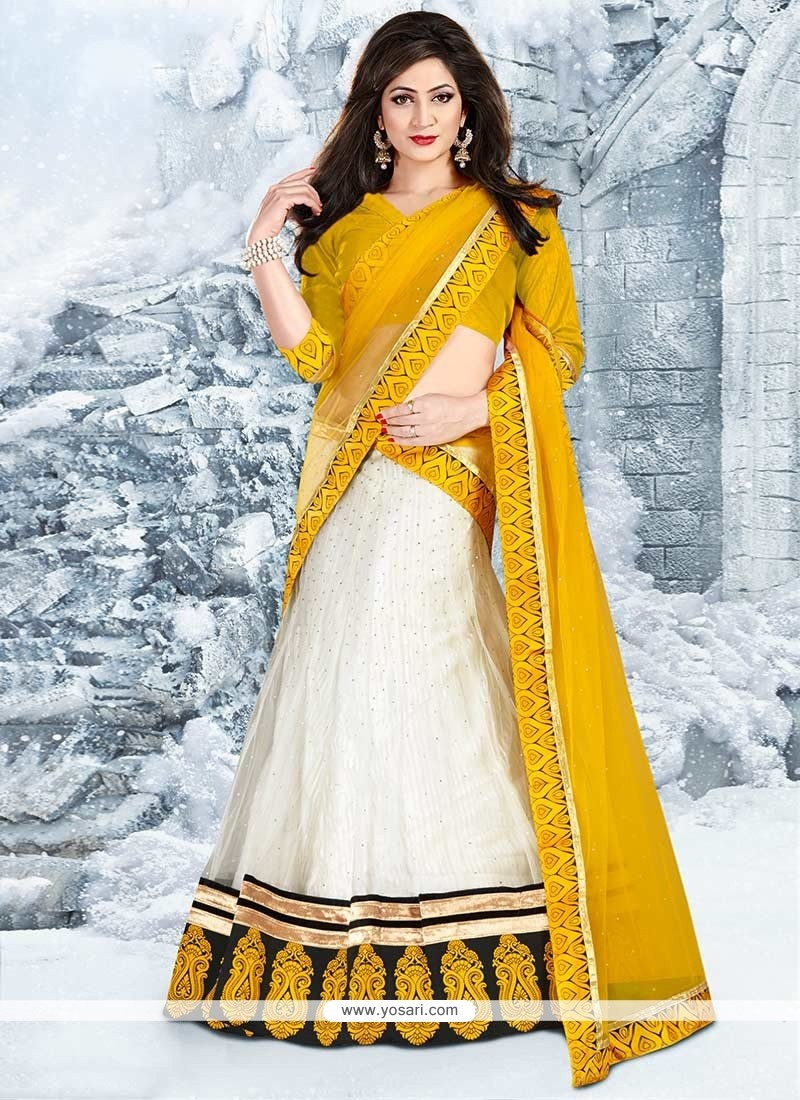 Off White And Mustard Embroidered Net Lehenga Choli