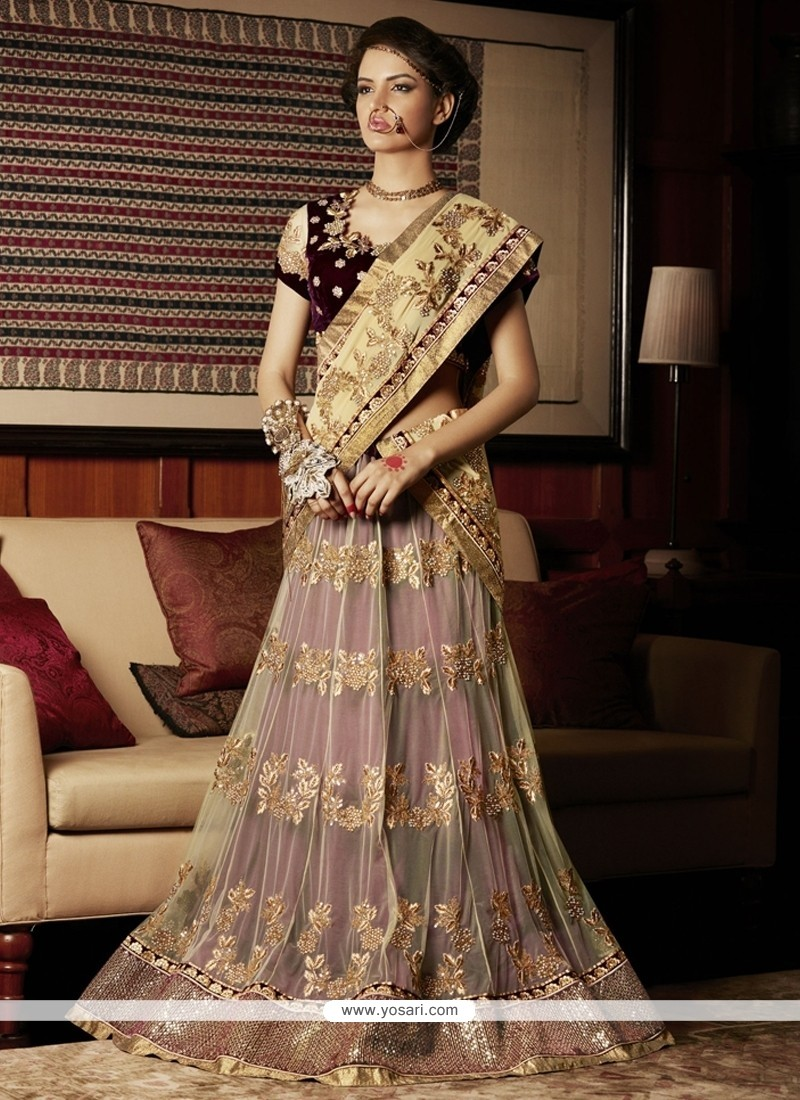 Riveting Net Cream And Maroon Lehenga Saree