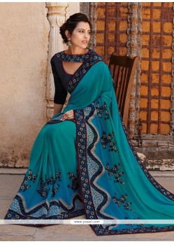 Flamboyant Teal Lace Work Georgette Designer Saree