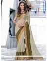 Staggering Cream And Green Embroidered Work Designer Saree