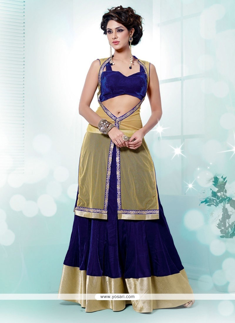 Royal Blue And Cream Patch Border Work Net Lehenga Choli