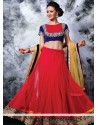 Opulent Red And Blue Velvet Net Lehenga Choli