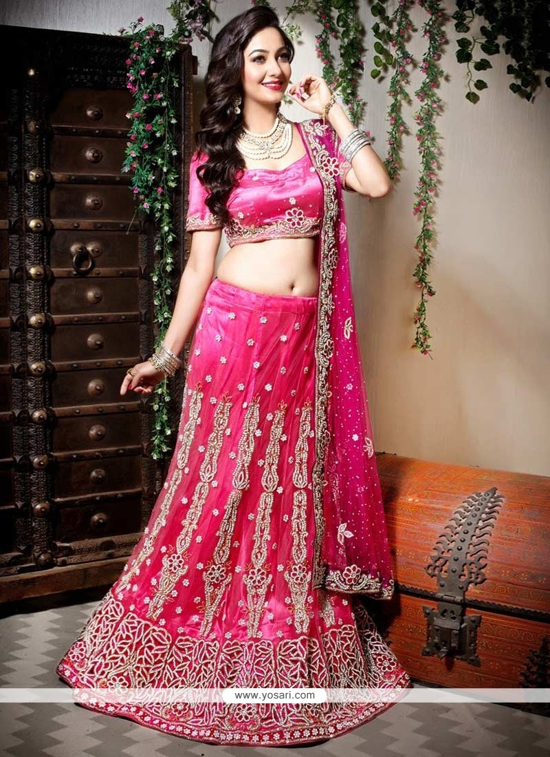 Deserving Pink Shade Net Fish Cut Lehenga Choli