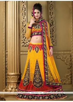 Modern Yellow Net Heavy Embroidered Lehenga Choli