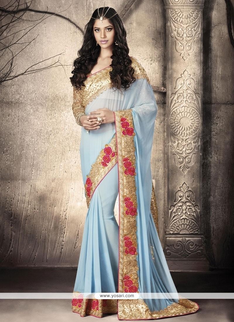 Hypnotizing Turquoise Embroidered Work Fancy Fabric Designer Saree