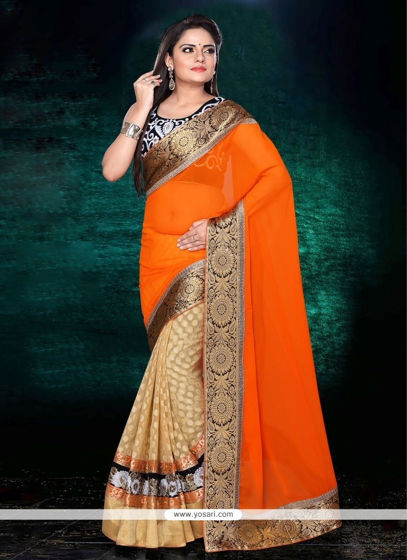 Fascinating Orange And Cream Georgette Designer Saree