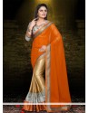 Conspicuous Orange And Cream Satin Designer Saree