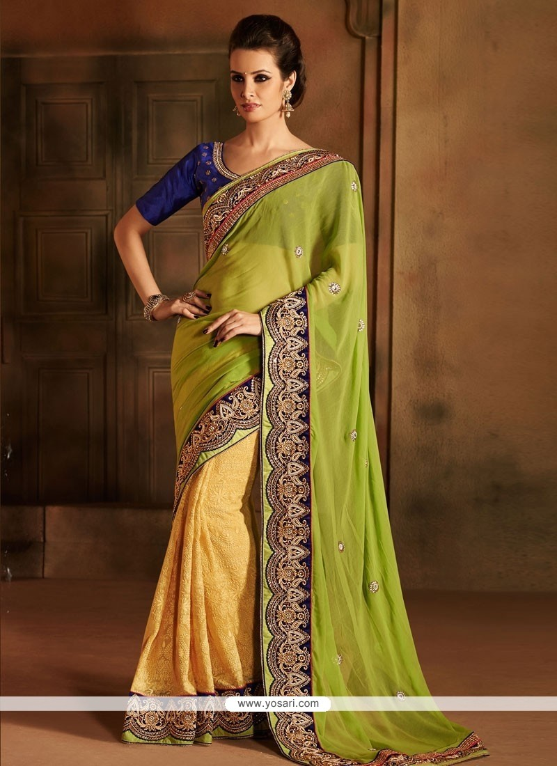Lustrous Green And Yellow Georgette Designer Saree