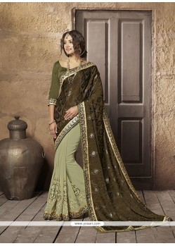 Entrancing Patch Border Work Brasso Designer Half N Half Saree