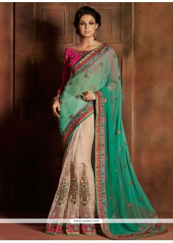 Opulent Cream And Green Net Designer Saree