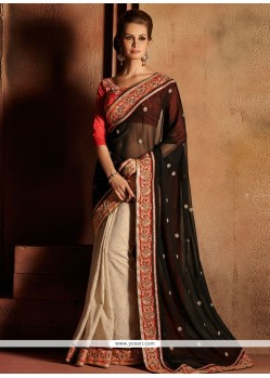 Markable Black And Cream Georgette Designer Saree