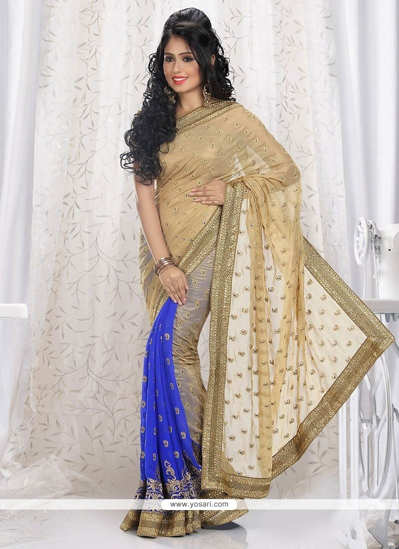 Breathtaking Beige And Blue Shimmer Georgette Saree