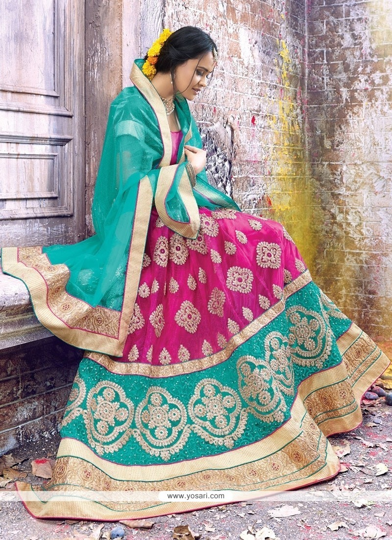 Alluring Net Hot Pink And Turquoise Patch Border Work A Line Lehenga Choli