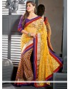 Pristine Yellow Net Brasso Party Wear Saree