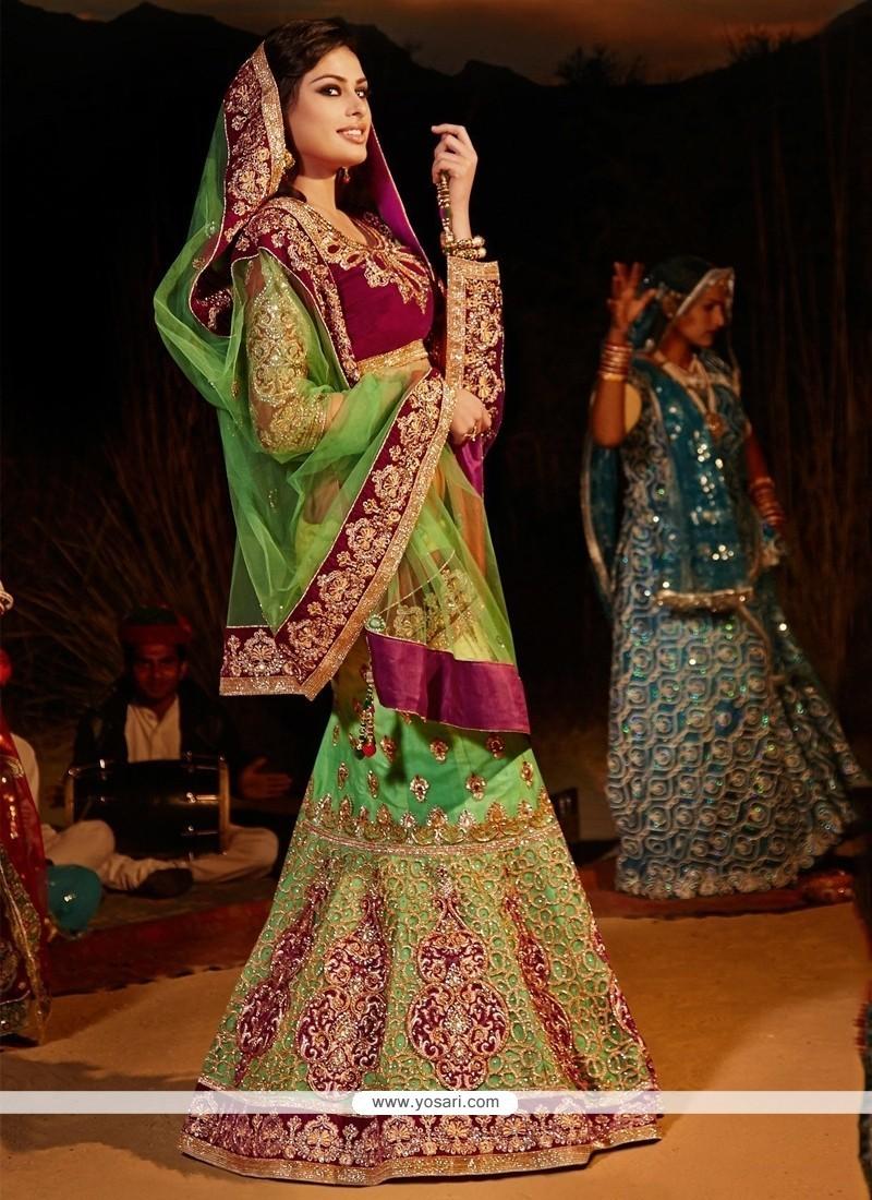 Flattering Embroidered Work Green Net A Line Lehenga Choli