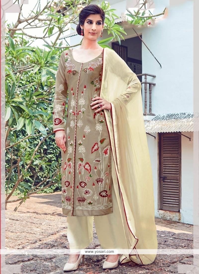 Trendy Cream Churidar Designer Suit