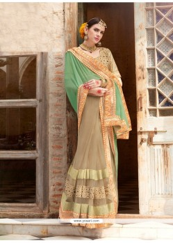 Bedazzling Beige And Sea Green Georgette Designer Saree