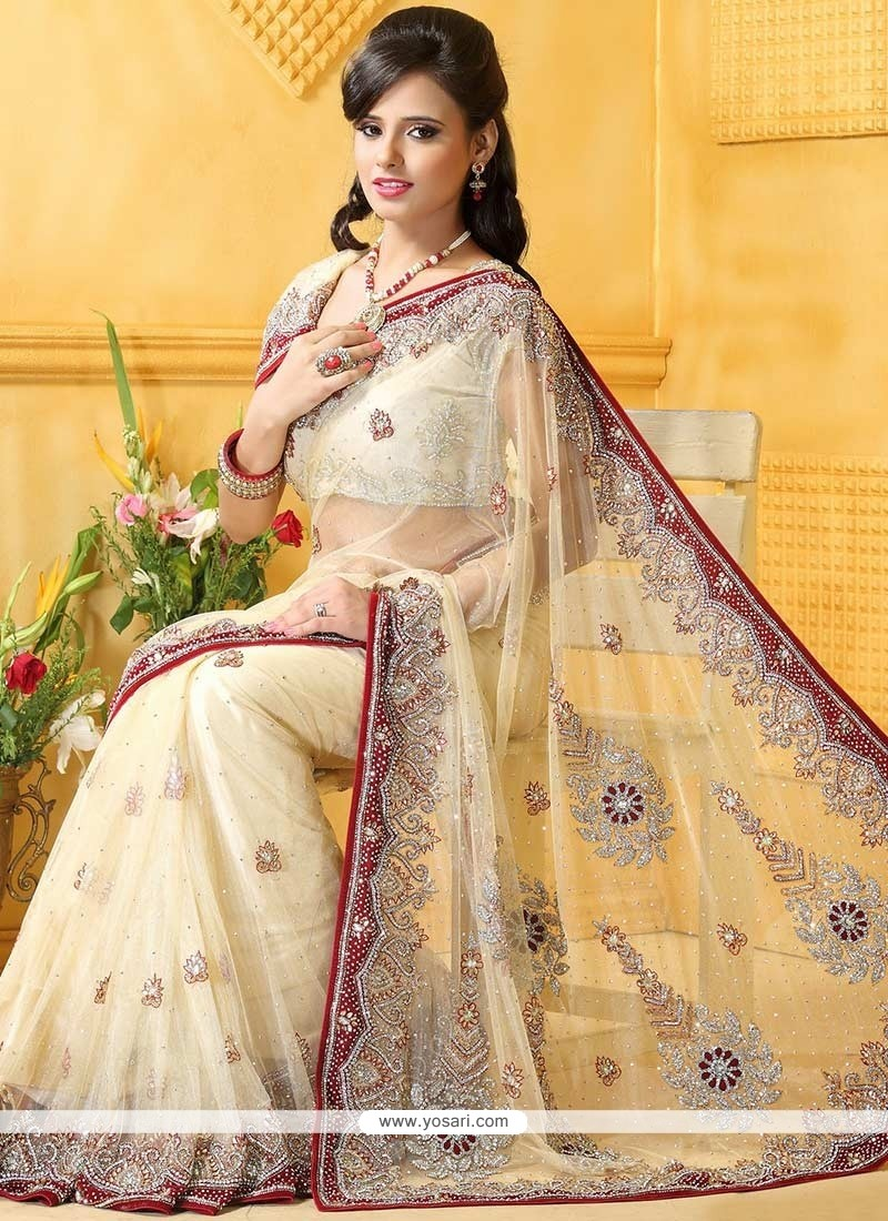 Conspicuous Cream Net Designer Saree