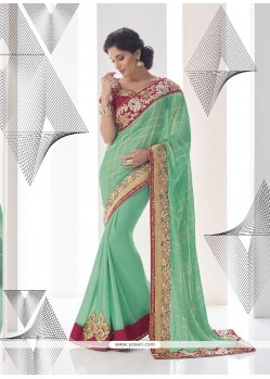 Classical Turquoise Embroidered Work Georgette Classic Designer Saree