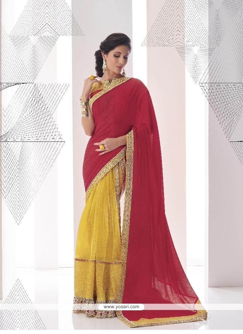 Savory Maroon And Yellow Classic Designer Saree