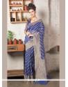 Prominent Zari Work Blue Jute Silk Designer Saree