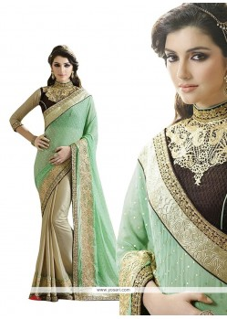Majestic Fancy Fabric Beige And Sea Green Patch Border Work Designer Saree
